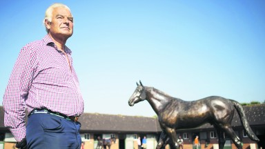 Paul Cole and the statue of Generous at his Whatcombe yard
