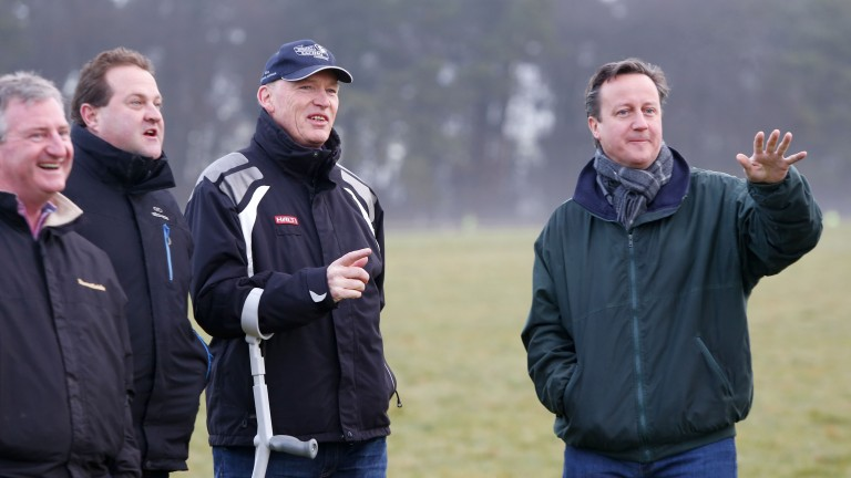 """David Cameron (right): told Parliament tells parliament he thinks it is """"worth having a proper look at the issue"""" of FOBTs"""