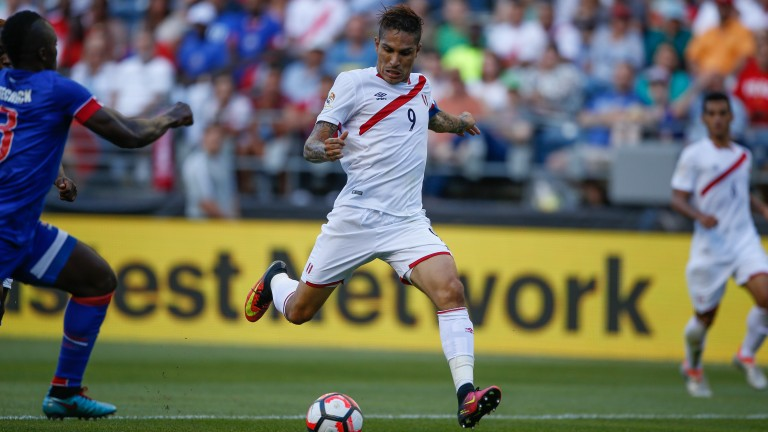 Paolo Guerrero scores for Peru in their opener against Haiti