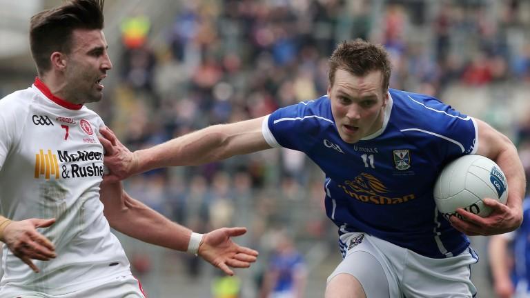 Gearoid McKiernan fends off Tiernan McCann: The Cavan man is not afraid of having a go at goal from distance