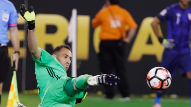 Colombia goalkeeper David Ospina saves a penalty in their quarter-final shootout