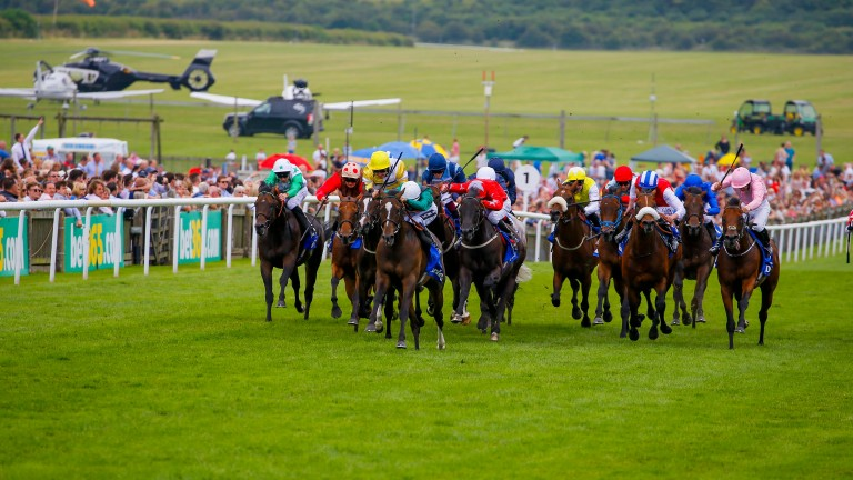 Limato (white cap) winning the 2016 July Cup