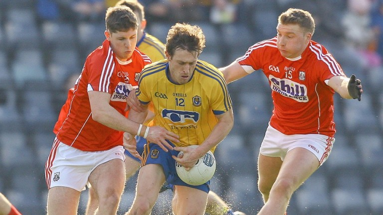 Roscommon's Conor Devaney is shackled by Cork's defence