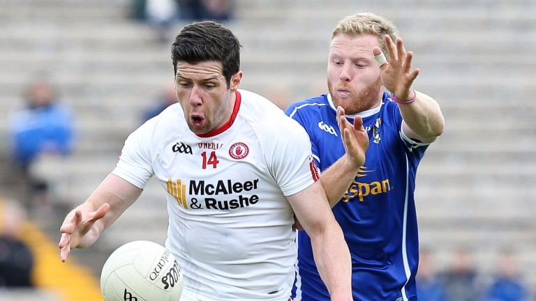 Tyrone's Sean Cavanagh (left) battles for the ball