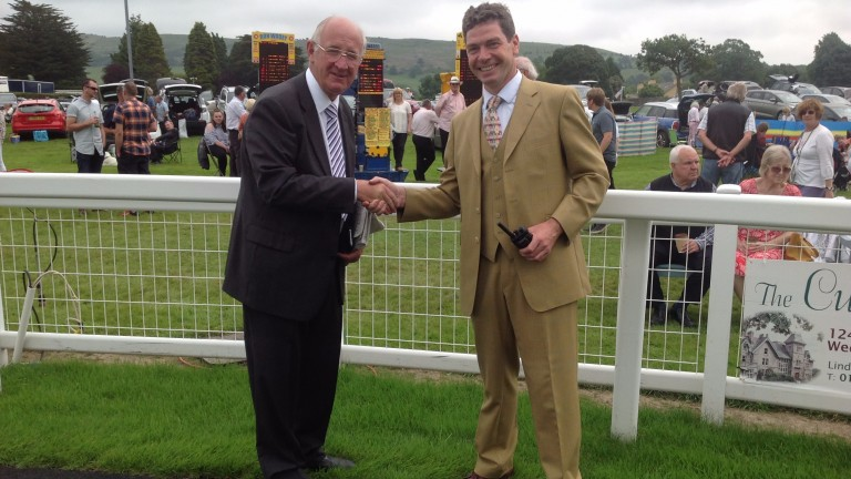Jonathan Garratt (right), dapper as ever on another busy day at Cartmel, with bookmaker Ron Wadey