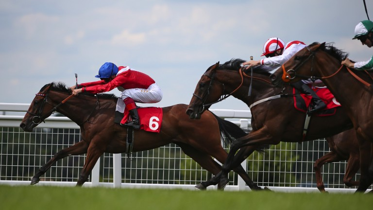 Pulling clear: On Her Toes (left) stretches out under Frankie Dettori en route to winning the 7f Listed event by three-quarters of a length