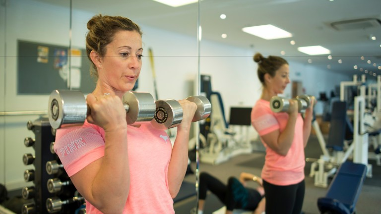Working out: Hayley Turner lifts weights in the gym at Goodwood House last week to prepare for the Shergar Cup