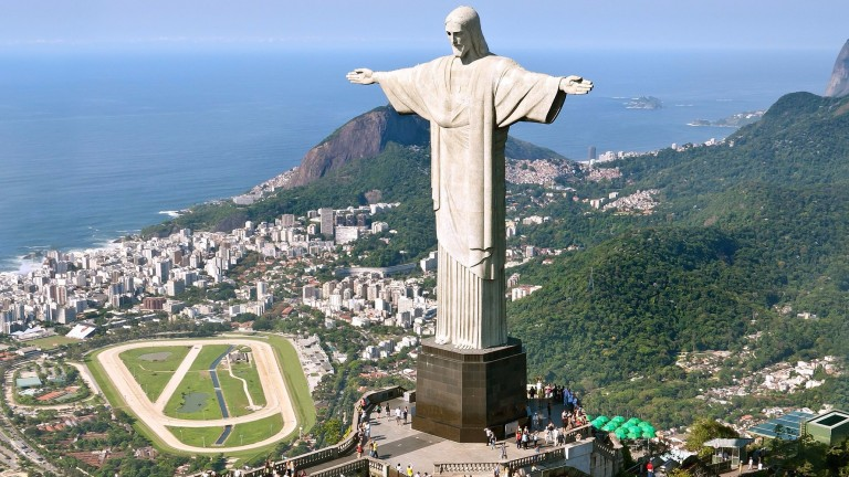 Picture-postcard setting: Gavea, Brazil's most celebrated racecourse, sits in the shadow of the arms-outstretched statue of Christ the Redeemer on Corcovado Hill in Rio de Janeiro