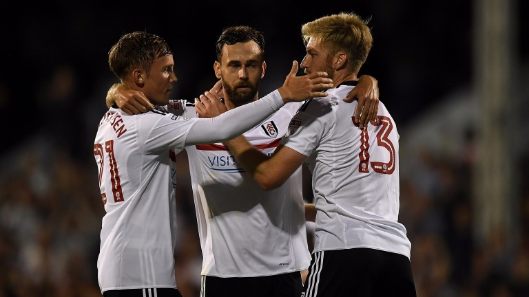 Fulham players celebrate victory over Newcastle United at Craven Cottage
