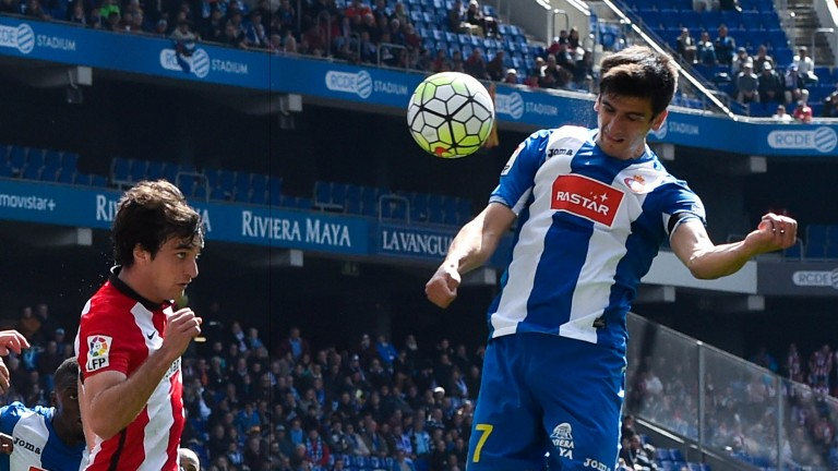 Espanyol's Gerard Moreno heads the ball