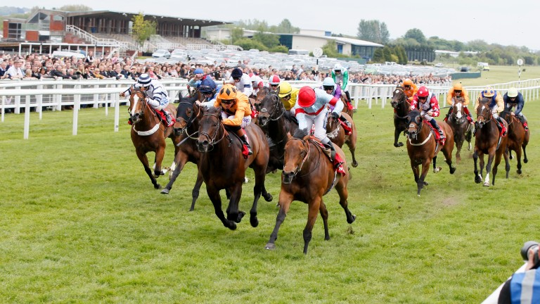 Hallelujah (red cap) wins at Newbury in May 2013, one of the five victories she attained under Hayley Turner