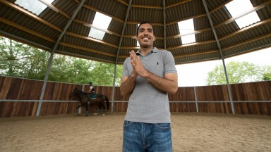 Sheikh Fahad observes his horses in the round pen at Longholes