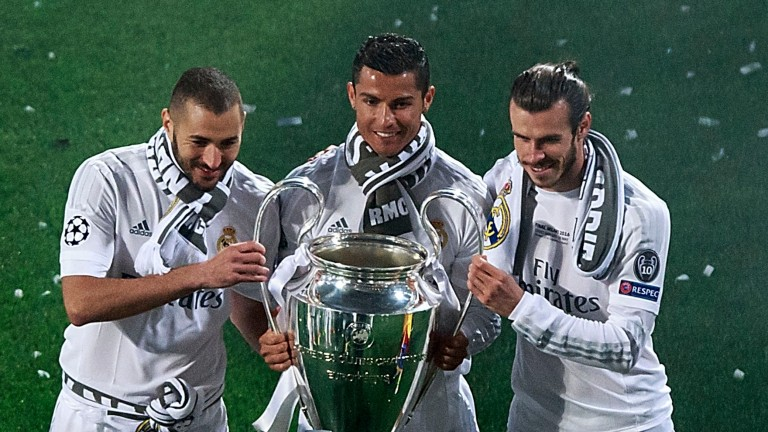 Cristiano Ronaldo (centre) with the Champions League trophy