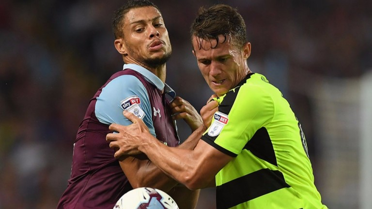 Huddersfield's Jonathan Hogg (right) tussles with Villa's Rudy Gestede