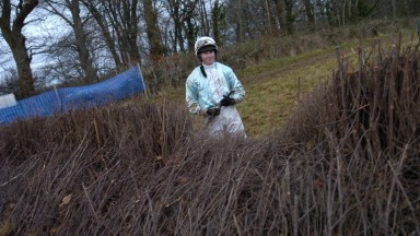 ALICE MILLS EXAMINES THE FENCE DAMAGE AFTER HER MOUNT SIGFORD'S WAY FELL IN THE MAIDEN RACE AT IDEFORD ARCH WHERE THE IDEFORD ARCH RACING CLUB HELD THEIR POINT-TO-POINT MEETING 30th DEC 2007 COPYRIGHT PIC; JOHN BEASLEY 01202 309489 MOBILE 07974 386458