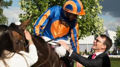 Aidan O'Brien congratulates Ryan Moore after Found's Prix de l'Arc de Triomphe success