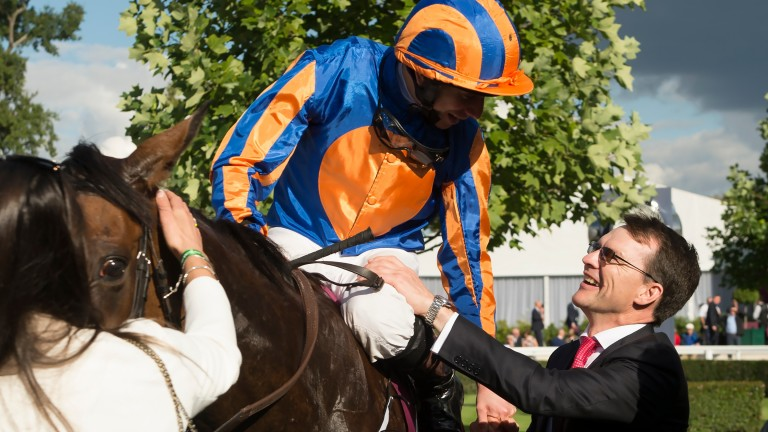 Aidan O'Brien greets Ryan Moore and Found after the pair led home a one-two-three for the sport's top trainer in the Arc