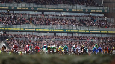 LIVERPOOL, ENGLAND - APRIL 14:  Runners and riders head toward the first fence during 165th John Smith's Grand National Steeple Chase at Aintree Racecourse on April 14, 2011 in Liverpool, England. The race was won by Daryl Jacob riding Neptune Collonges.