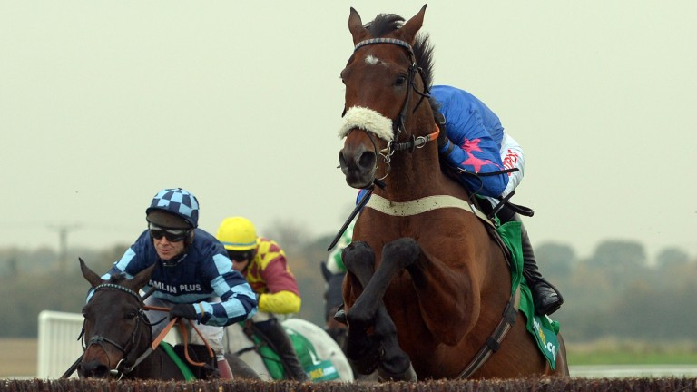 Cue Card leads Menorah and Dynaste in last year's bet365 Charlie Hall Chase