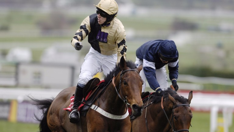 Regaining the crown: Inglis Drever holds off Mighty Man to reclaim his title in the World Hurdle under Paddy Brennan in 2007