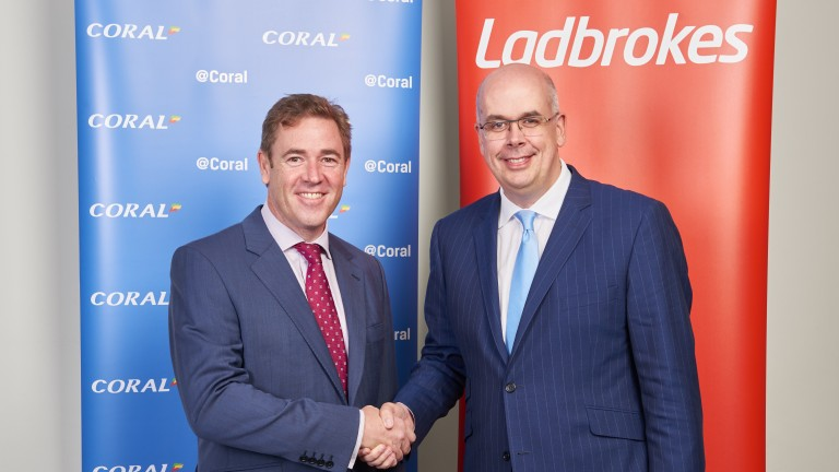 Gala Coral chief executive Carl Leaver (left) and Ladbrokes chief executive Jim Mullen shake on their deal
