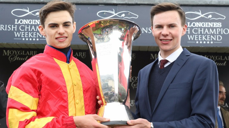 Donnacha and Joseph O'Brien with the Moyglare Stud Stakes trophy