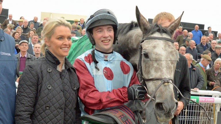 Jonathan Moore with trainer Rebecca Curtis and Irish Cavalier after the jockey's biggest career success in the Charlie Hall Chase at Wetherby