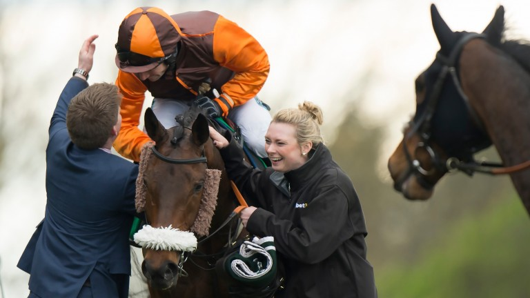 Neil Mulholland celebrates after The Young Master wins the bet365 Gold Cup at Sandown