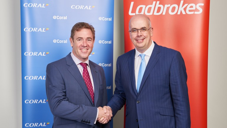 Gala Coral chief executive Carl Leaver (left) and Ladbrokes chief executive Jim Mullen shake on their merger last year