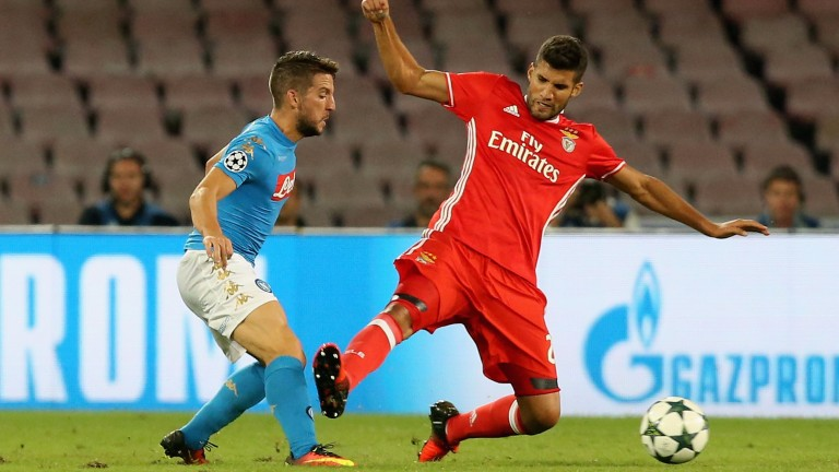 Benfica's Lisandro Lopez tackles Dries Mertens