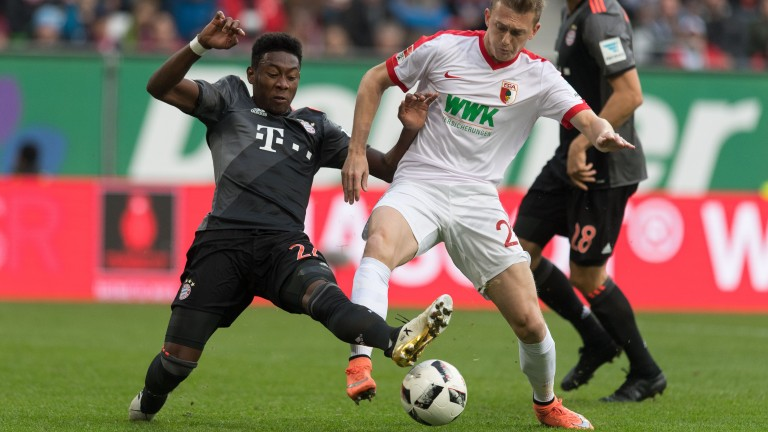 Bayern Munich's David Alaba puts in a tackle