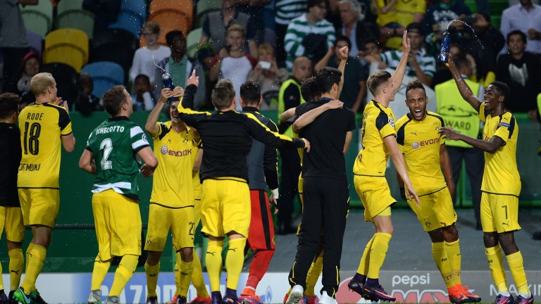 Borussia Dortmund players celebrate victory in Lisbon