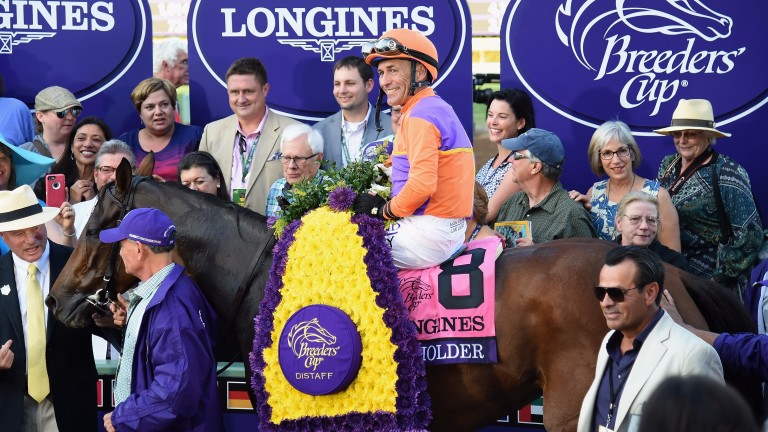 Beholder and Gary Stevens pose for their post-race photographs after their thrilling Distaff triumph over Songbird
