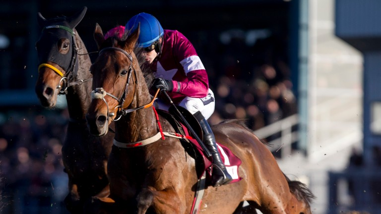 Valseur Lido and Ruby Walsh on the way to victory in the JNwine.com Champion Chase at Down Royal