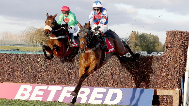 Thomas Brown (right) on his way to victory under Niall Madden in the 2m4f handicap chase