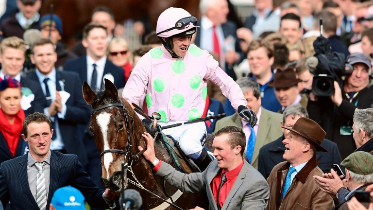 Ruby Walsh celebrates with trainer Willie Mullins after victory on Vautour in the JLT Novices' chase