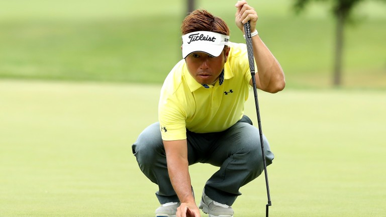 Michio Matsumura weighs up a putt at the Bridgestone Invitational