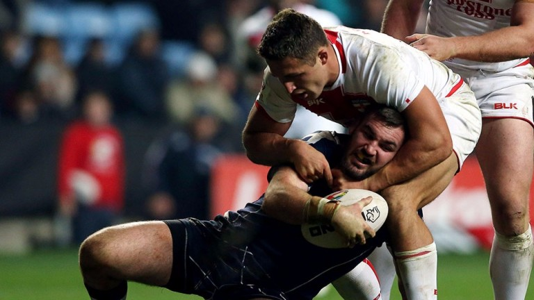 Scotland?s Luke Douglas (left) is tackled by England?s Sam Burgess
