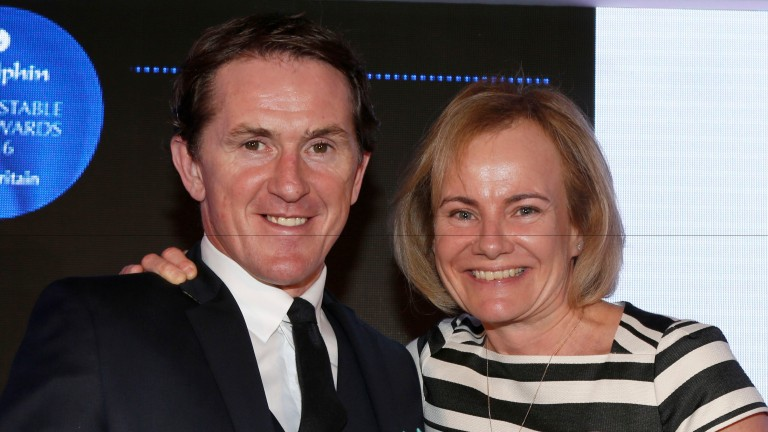 Lisa Delany collects her award from Sir Anthony McCoy