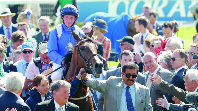 Sheikh Hamdan leads in Taghrooda and Paul Hanagan after their victory in the 2014 Oaks