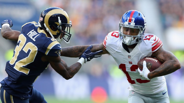 Odell Beckham junior (right) hands off Troy Hill