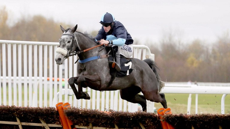 Strike one: Brian Hughes lands the opening handicap hurdle on Mitcd
