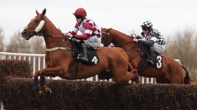 Strike four: Blue Kascade makes it four on the day for Brian Hughes in the 3m handicap chase