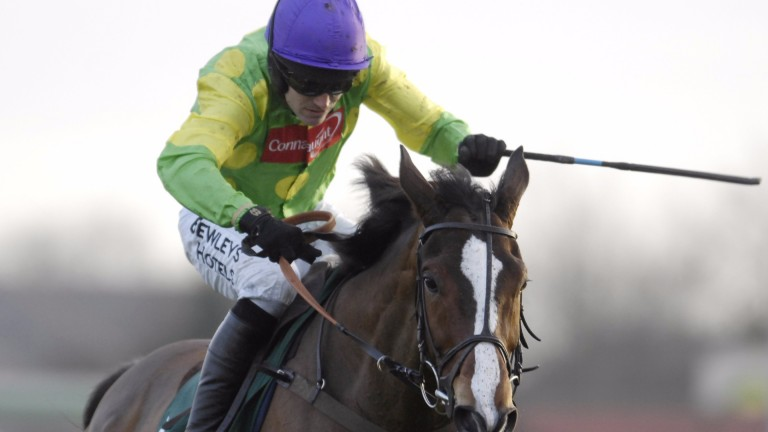 Kempton 26.12.07 Picture:Edward WhitakerRuby Walsh and Kauto Star clear the last on the way to winning the King George