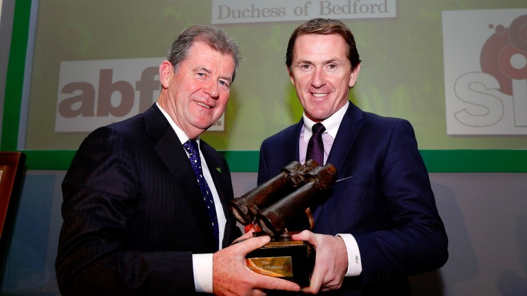 JP McManus presents Sir Anthony McCoy with his award in 2015