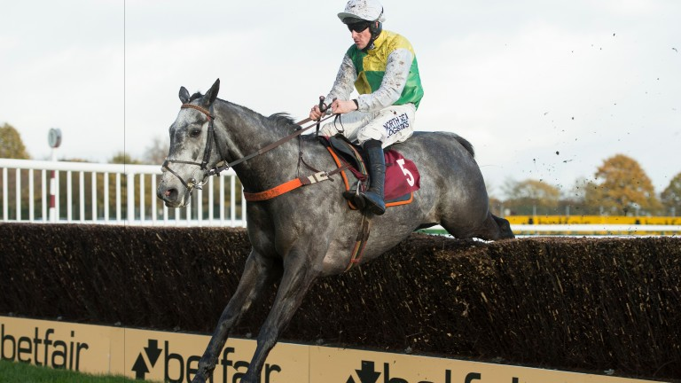 Cloudy Dream (Brian Hughes) jumps the last on his way to victory in the graduation chase