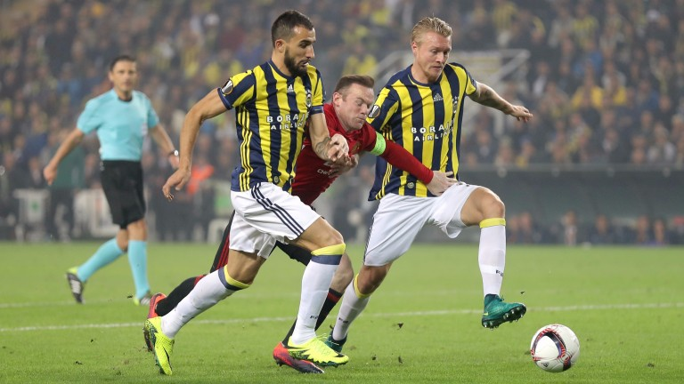 Wayne Rooney is crowded out by the Fenerbahce defence