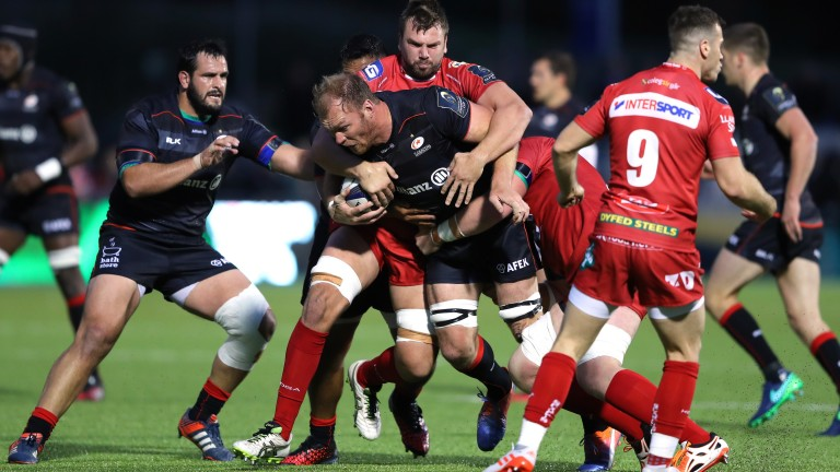 Saracens backrower Schalk Burger occupies the attention of the Scarlets defence in the Champions Cup
