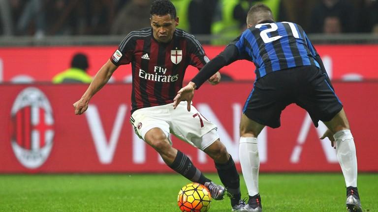 Carlos Bacca and Davide Santon battle in a Milan derby last season
