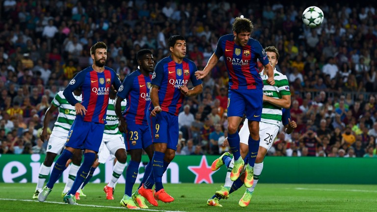 Barcelona's Sergi Roberto clears a corner against Celtic